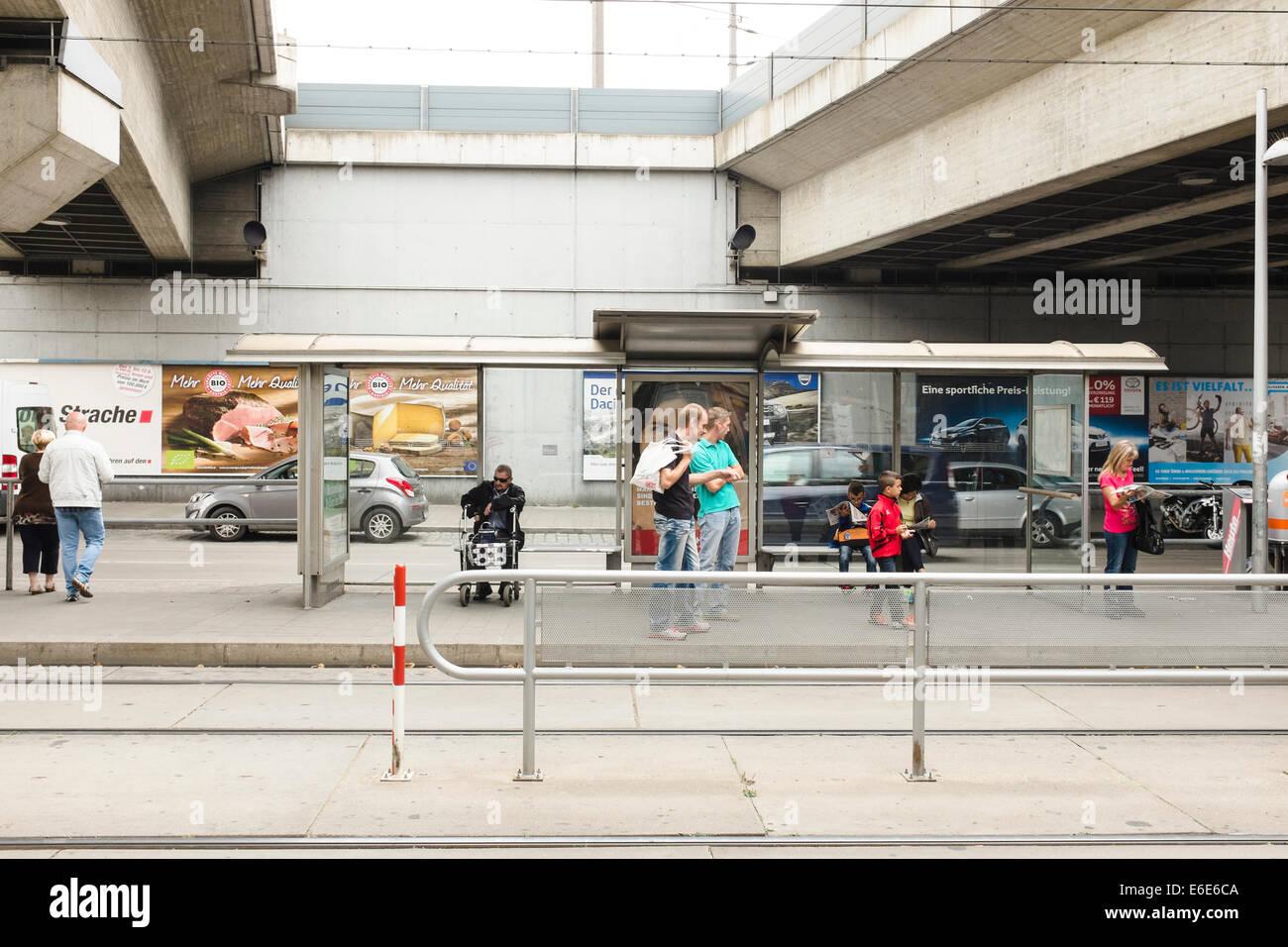 People on tram stop, Simmering, Vienna - Stock Image