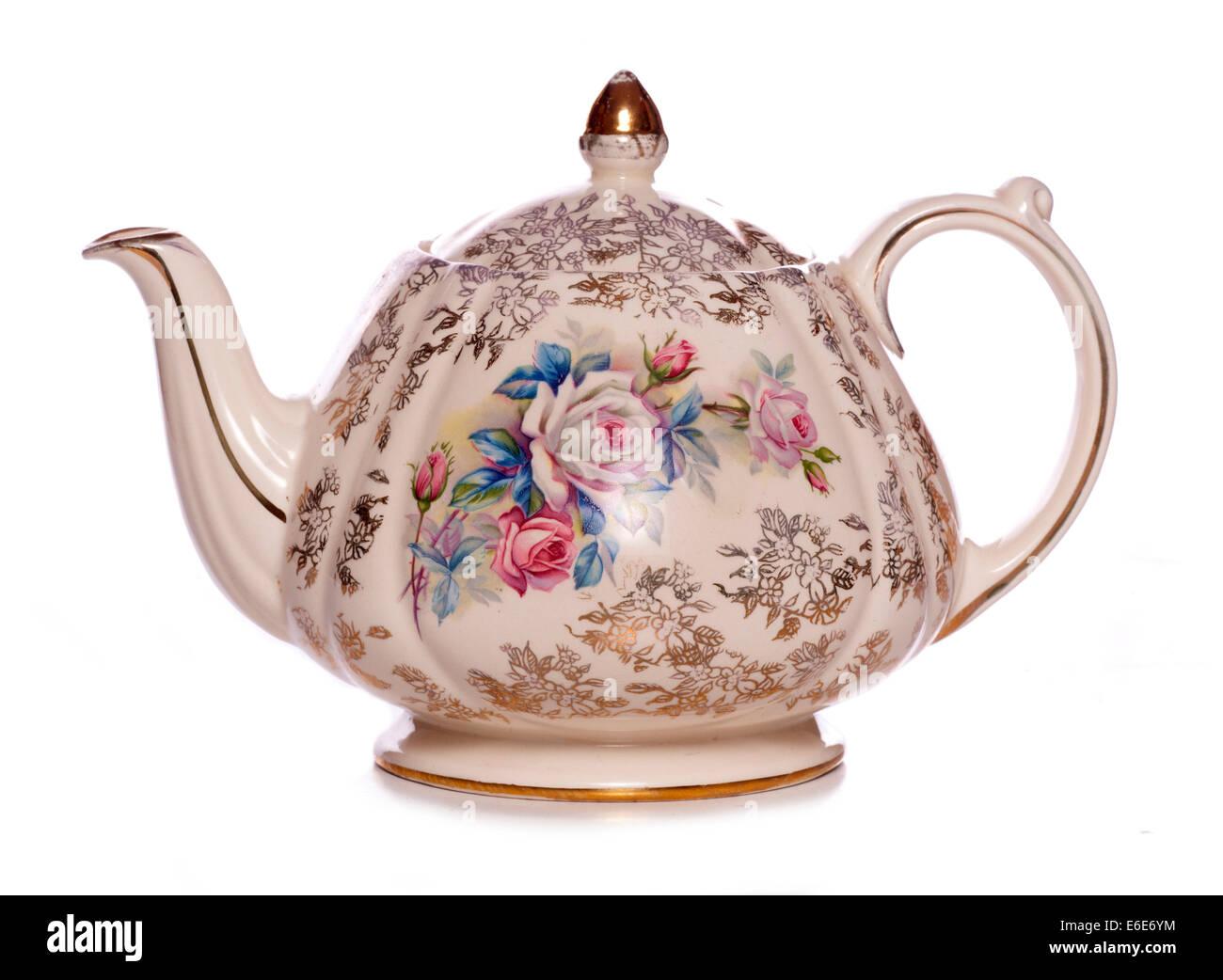 vintage floral tea pot studio cutout - Stock Image