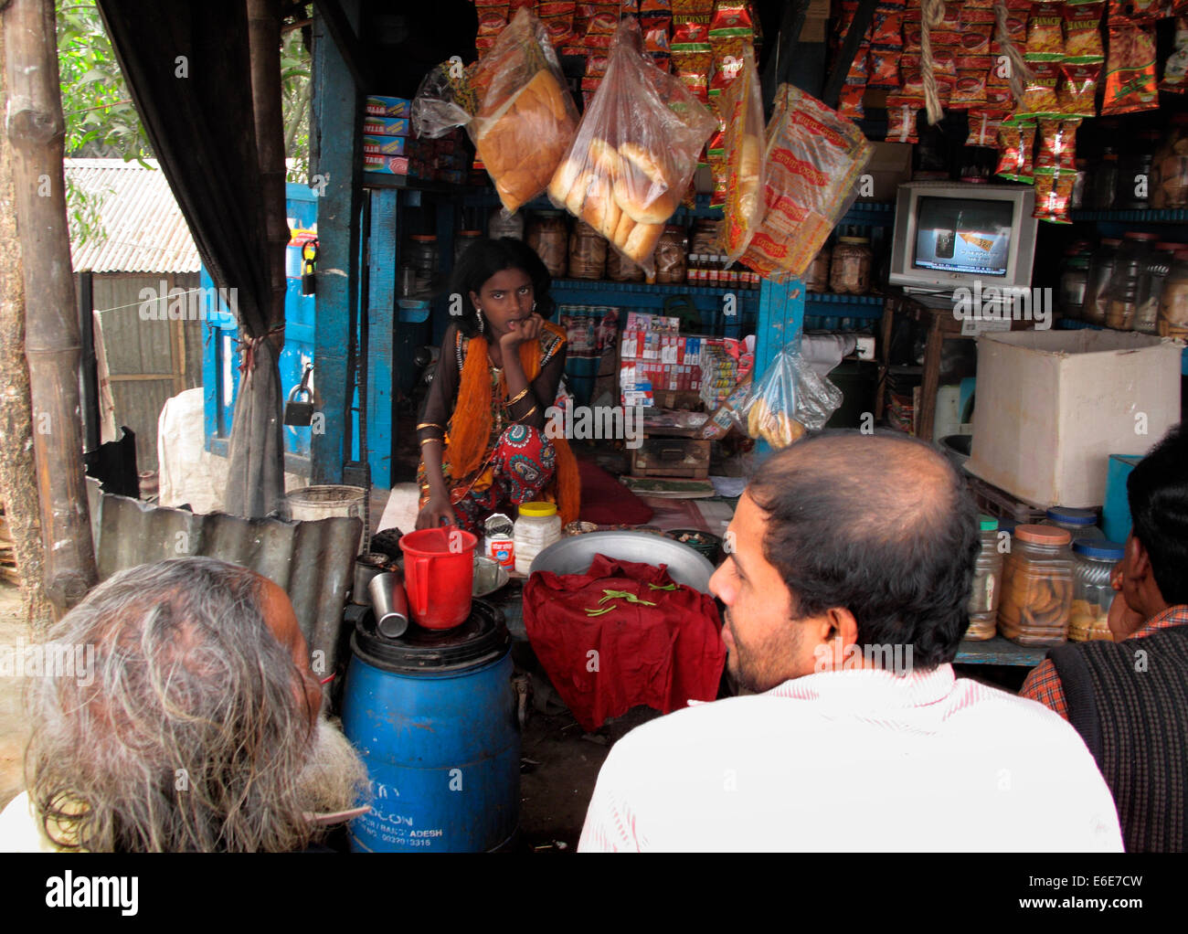 Kids running family store,road side vendors in Bangladesh,Hi teak shed,tea - Stock Image