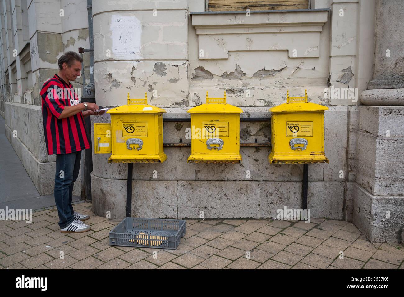Postman sorting out post at Post Office building, Osijek, Slavonia, Croatia - Stock Image