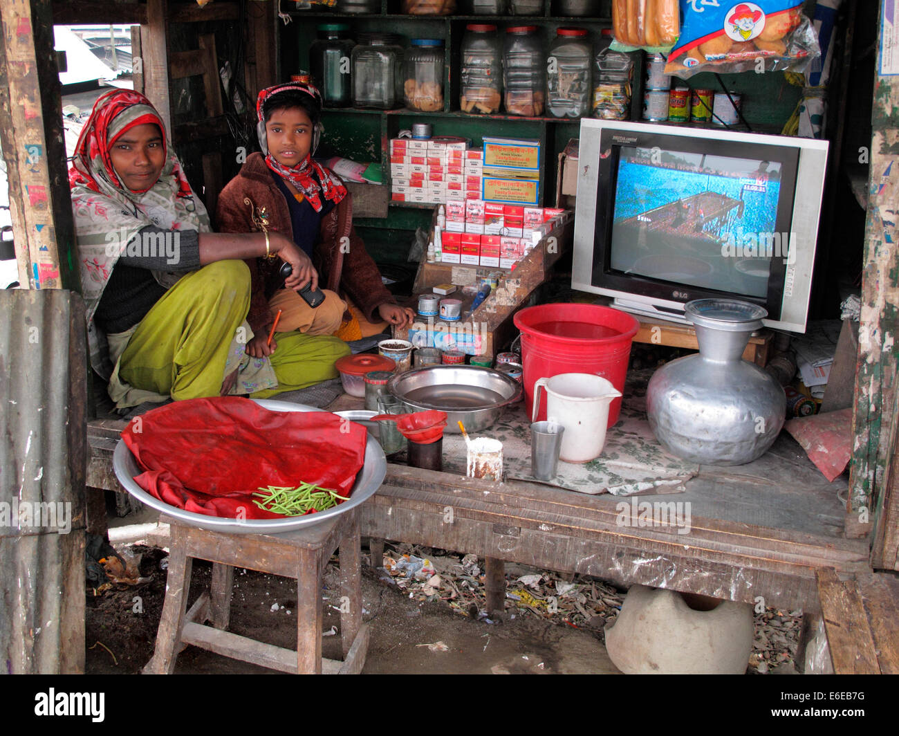 Kids running family store,road side vendors in Bangladesh,Hi teak shed, - Stock Image
