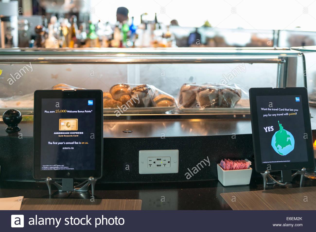 Restaurants using digital technology for self serving regarding the customer self service - Stock Image