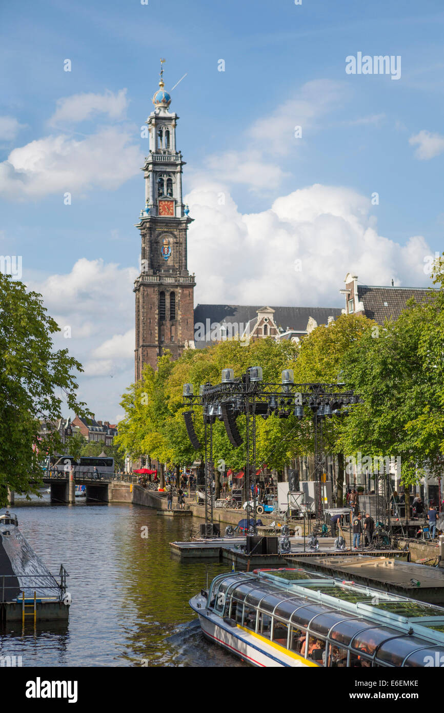 View on one of the canals of Amsterdam 'de Prinsengracht' with sightseeing boat and a church 'Westerkerk' - Stock Image