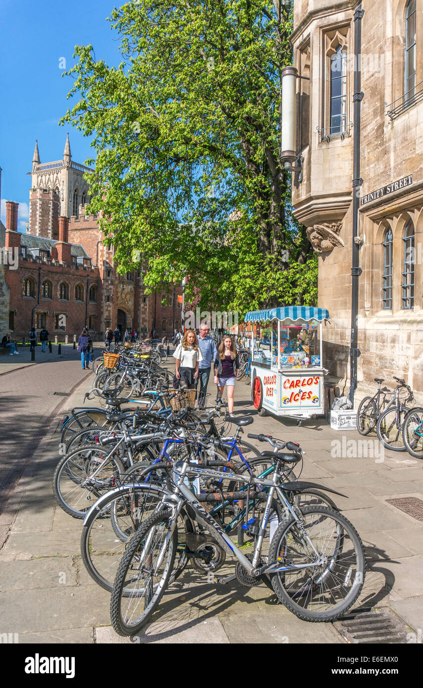 Line of bikes / bicycles on Trinity Street, with part of a university college in the background. City centre, Cambridge, Stock Photo