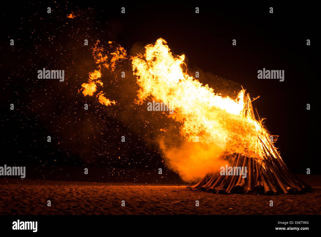 Bonfire during on a hot summer night - Stock Image