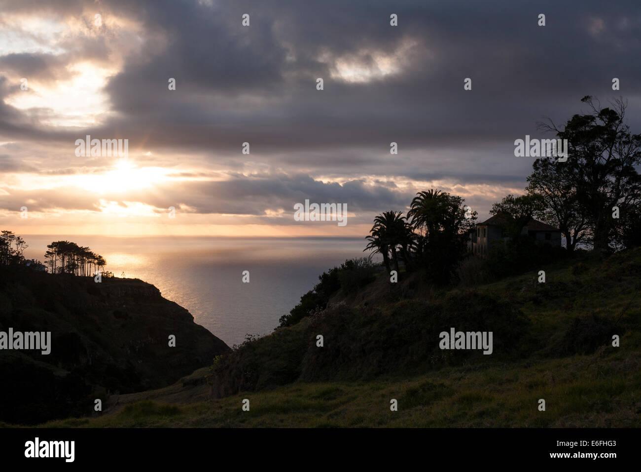 A sunset view down a valley below Serrado near Ponta do Pargo, Madeira. - Stock Image