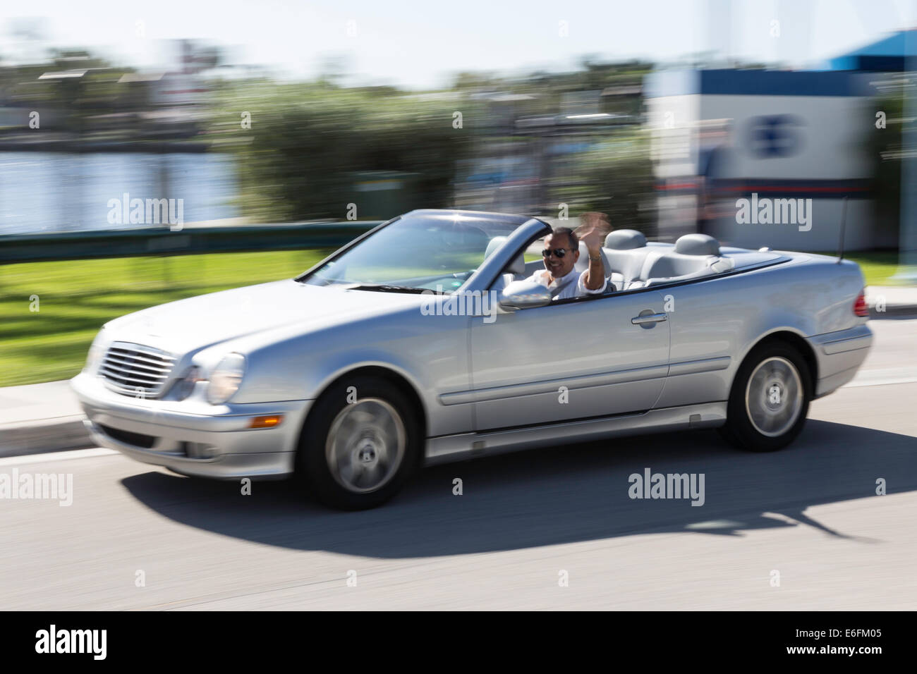 Caucasian Man Driving Luxury Convertible Car, Ft Lauderdale, FL, USA - Stock Image