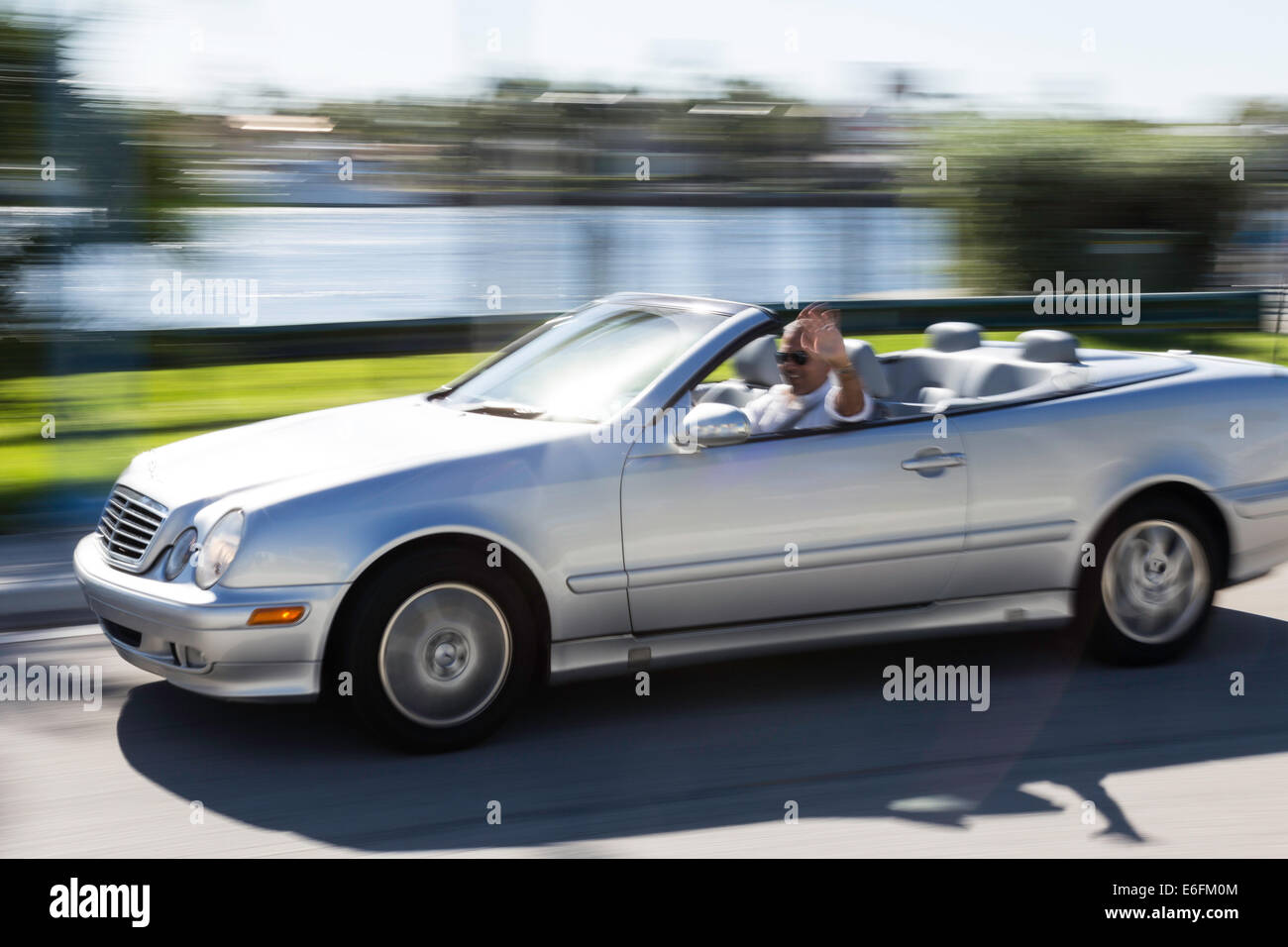 Caucasian Man Driving Luxury Convertible Car, Ft Lauderdale, FL, USA Stock Photo