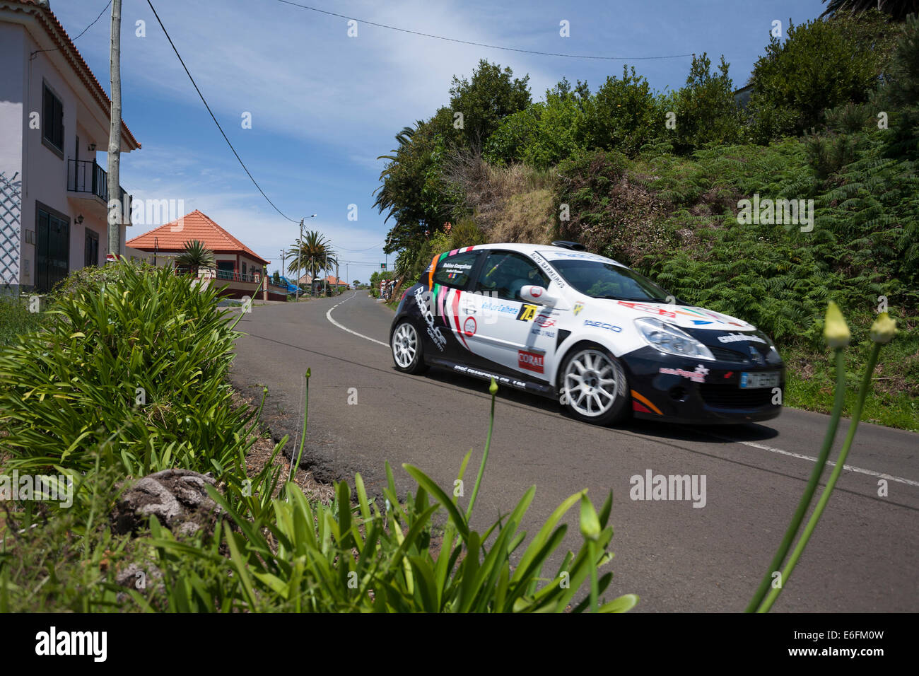 A competitor of the 8th Rally of Calheta races past near Serrado in May 2012. - Stock Image
