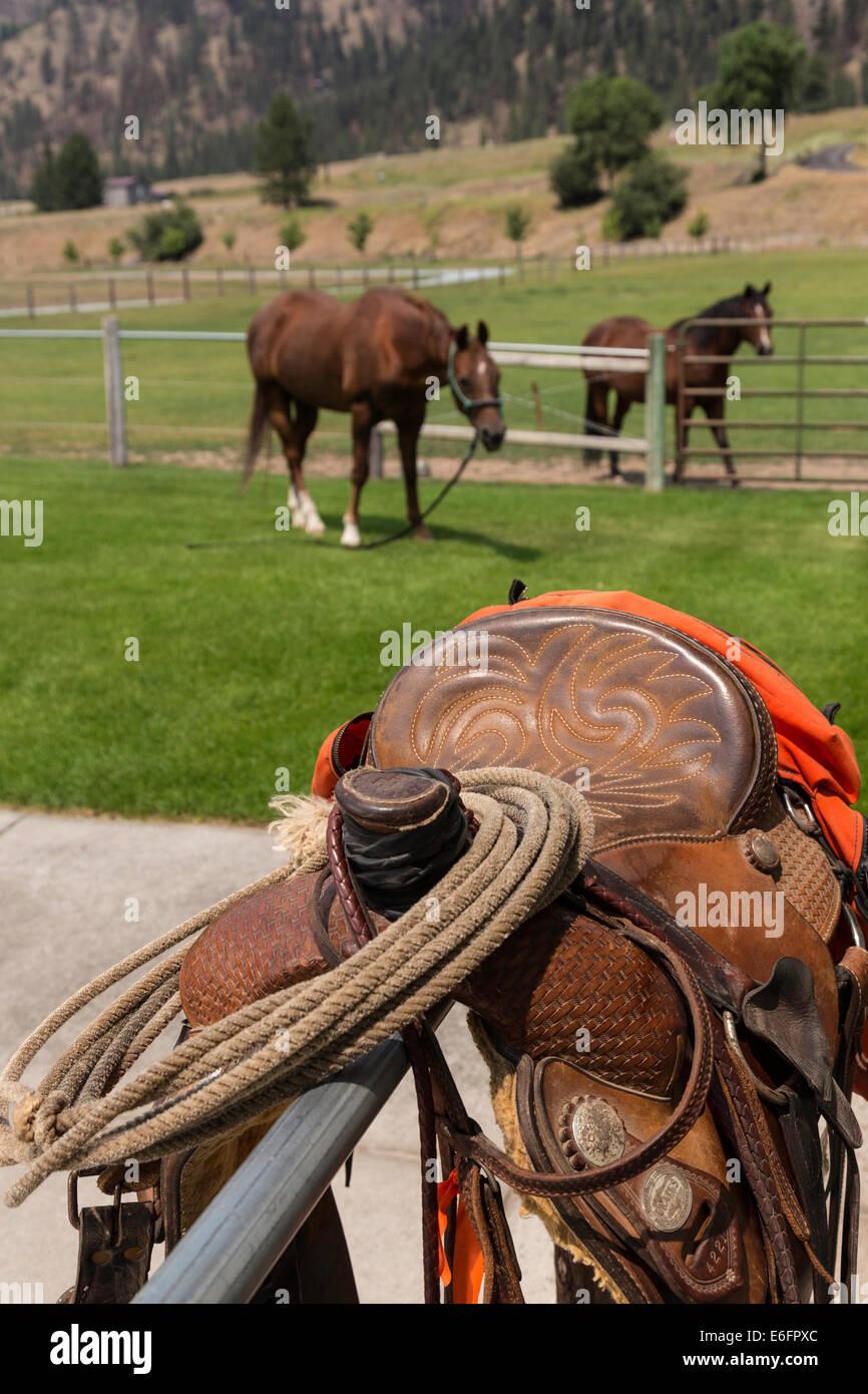 Tooled Leather Saddle on Hitching Post, Montana - Stock Image