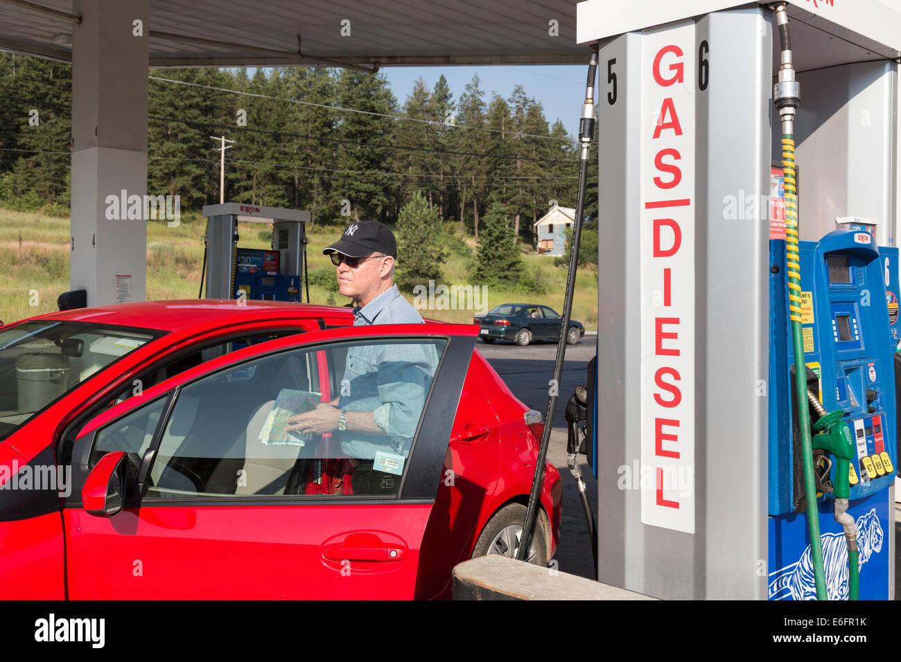 Driver Checking Map at Gas Station, Montana, USA Stock Photo ...