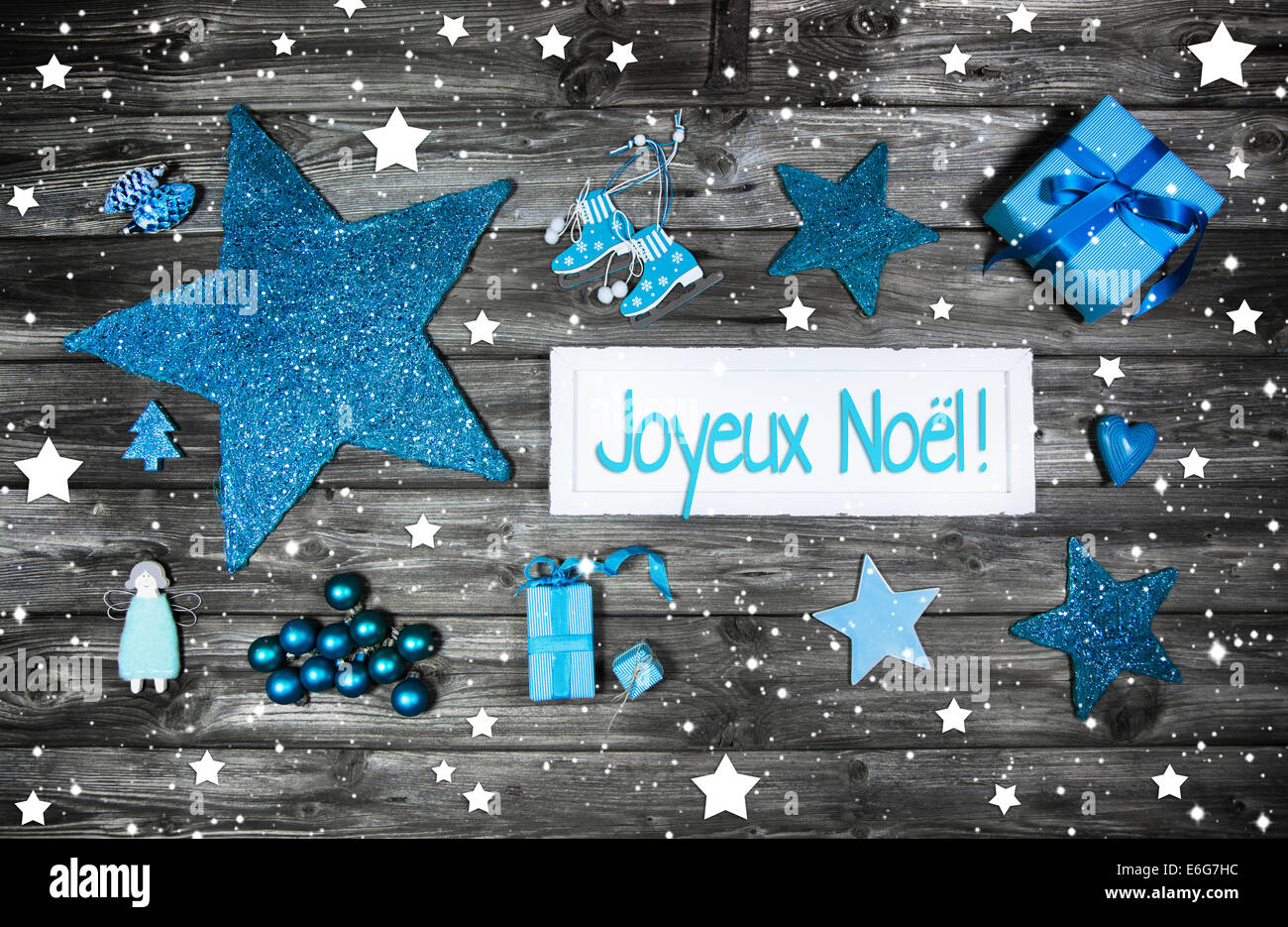 Merry christmas card or voucher. Xmas decoration in blue, white on grey wooden background with french greetings. - Stock Image
