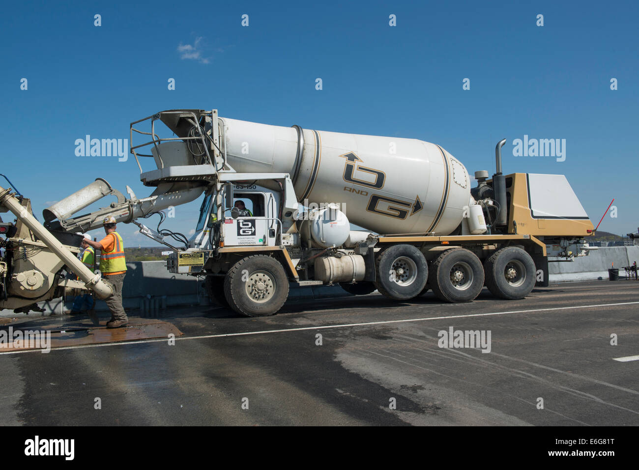 Concrete mixer combines  cement, gravel or sand, and water to make concrete on I-95 Harbor Crossing Project in New - Stock Image