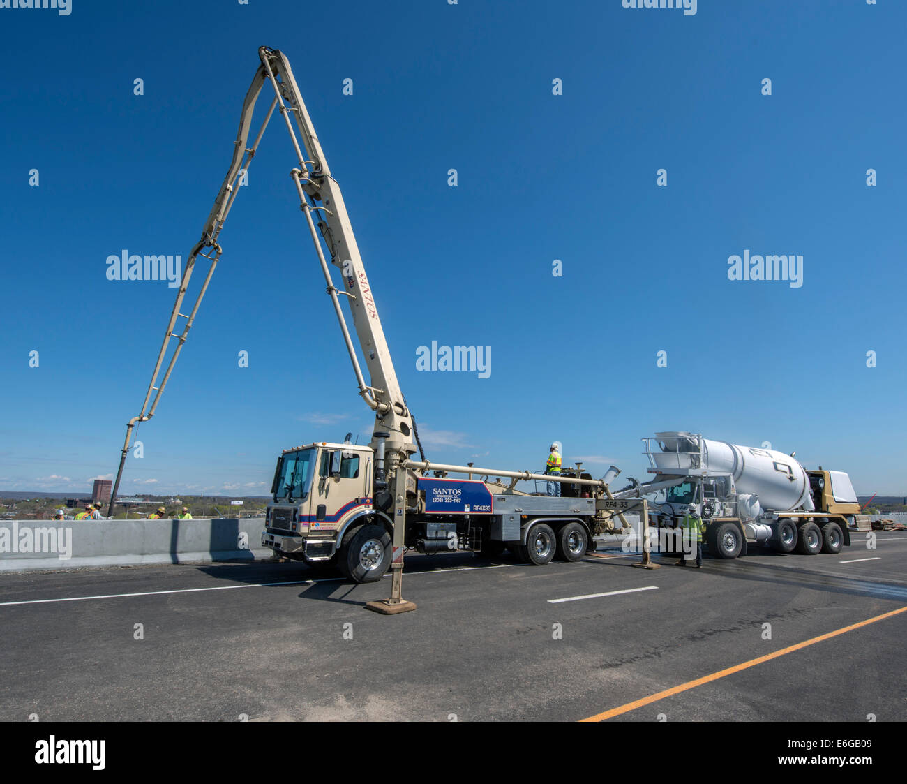Pumper truck and concrete mixer on I-95 New Haven Harbor Crossing Project. - Stock Image