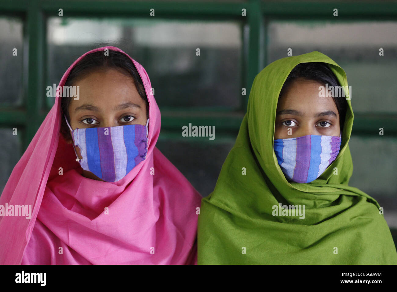 Dhaka, Bangladesh. 24th Mar, 2014. Mim & Sonia two sister ages of 13 & 15.They are affectd by TB & got - Stock Image