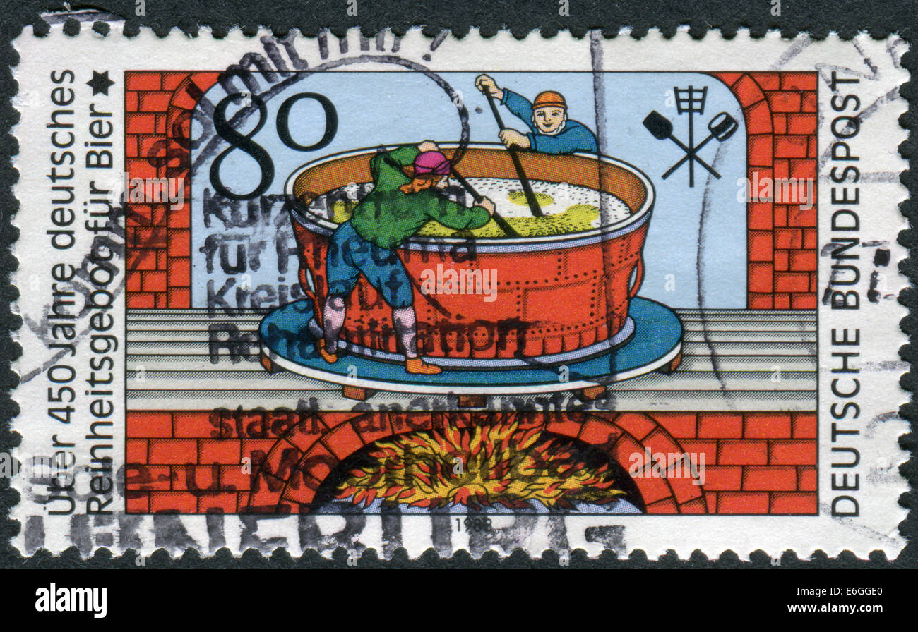 Stamp printed in Germany, 450th anniversary of Beer Pureness law, depicts an engraving (1677), brewers of Quedlinburg - Stock Image