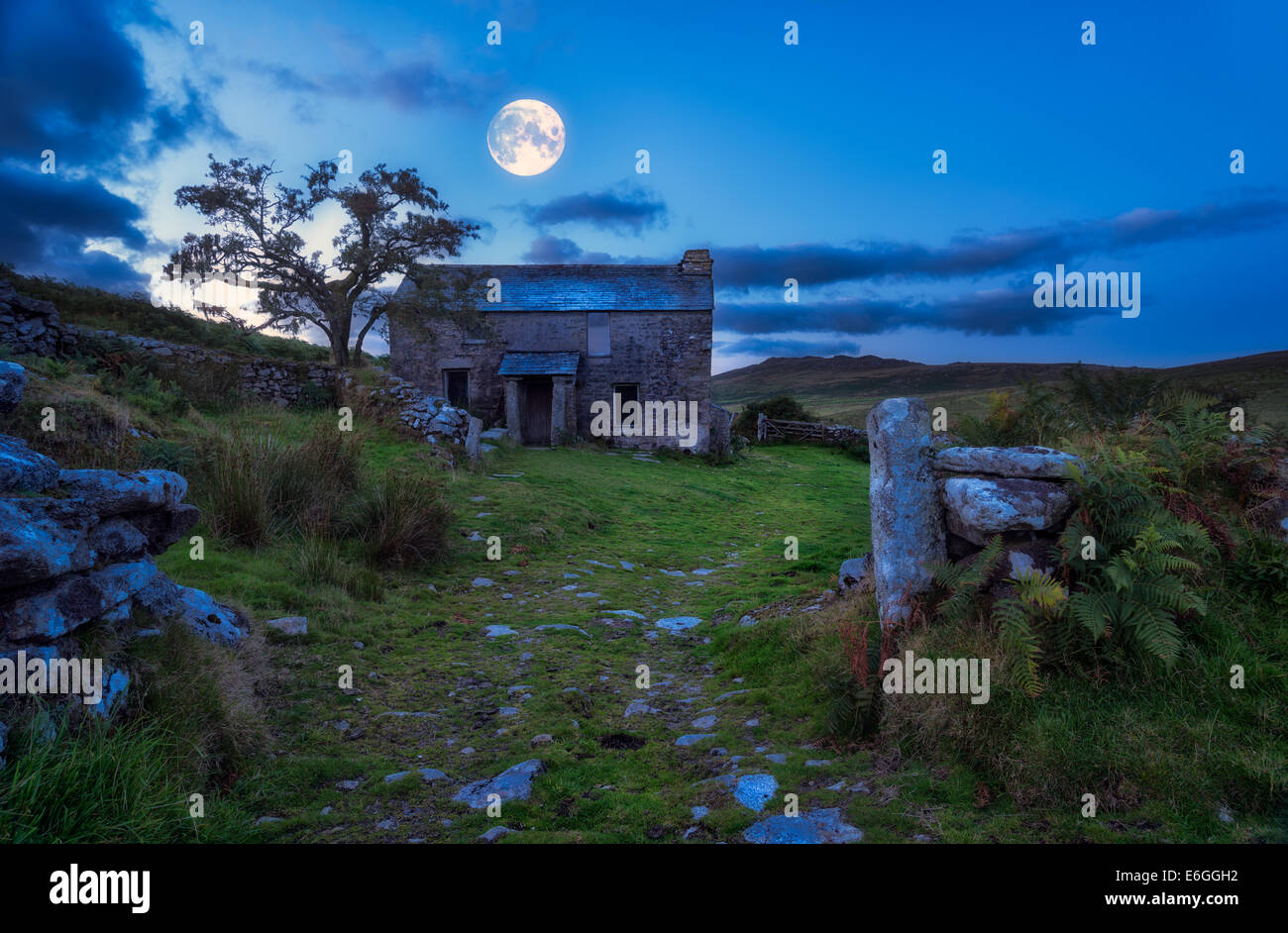 Creepy derelict haunted house under a full moon  (Elements of this image (moon) furnished by NASA) - Stock Image