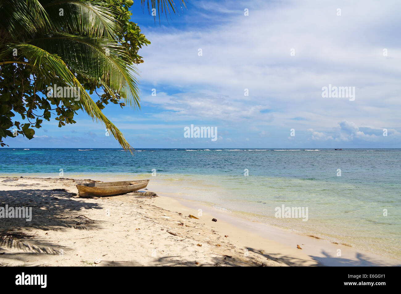 tropical beach of an Caribbean island with a dugout canoe on the sand, Zapatilla cays, Panama - Stock Image