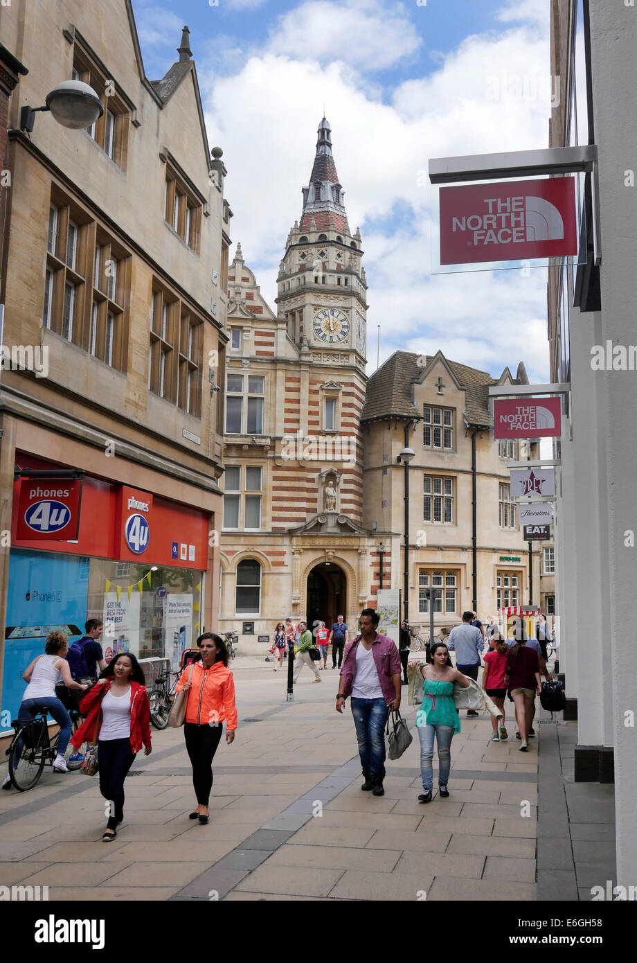 Petty Curry pedestrian shopping street and old Foster Bank Building (Lloyds TSB) with clock tower, central Cambridge, - Stock Image