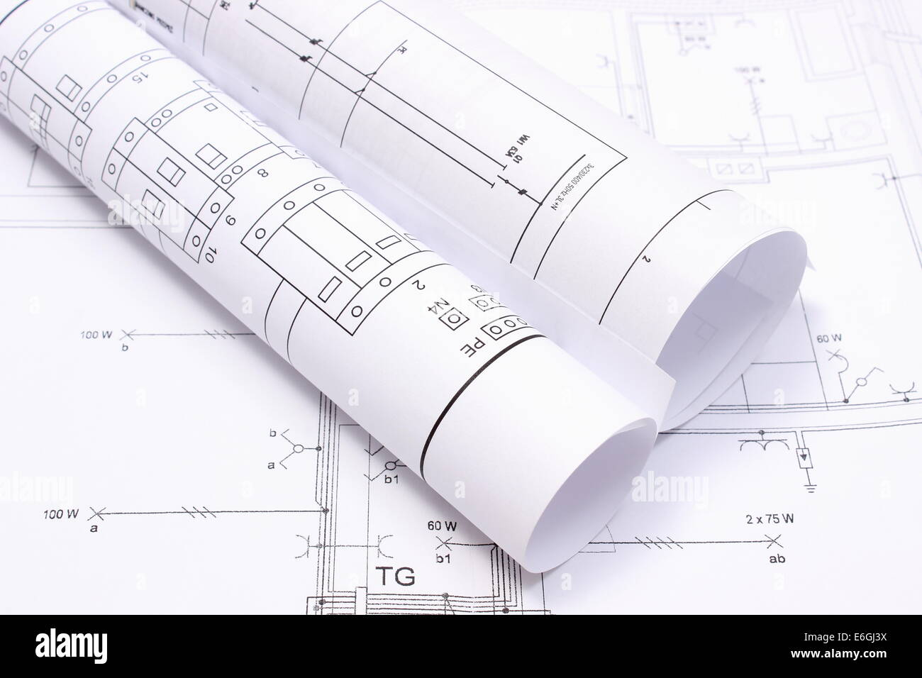 Rolled Electrical Diagrams Lying On Construction Drawing Of House In Drawings For The Projects Engineer Jobs