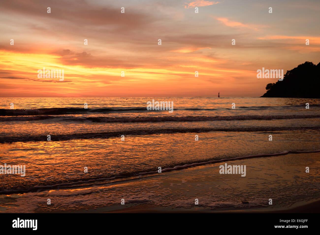 Sunset over Kota Kinabalu beach Borneo Malaysia - Stock Image