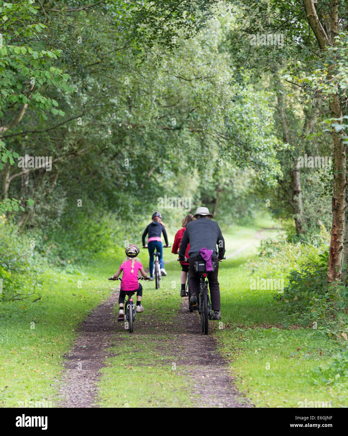 family cycling in the Consall Valley popular with tourists in Staffordshire - Stock Image