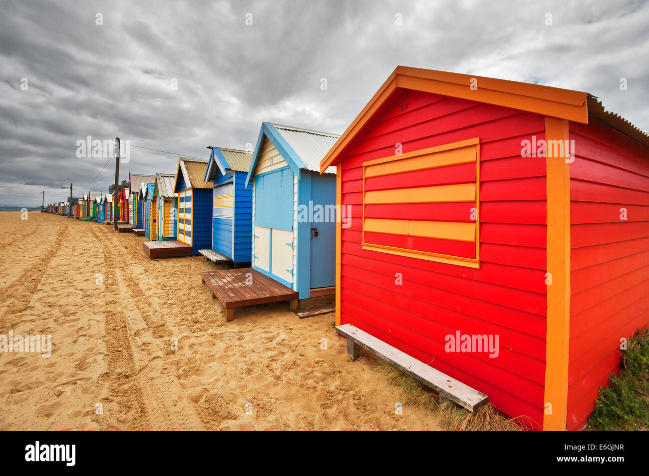 Colourful bathing boxes at Brighton Beach. - Stock Image