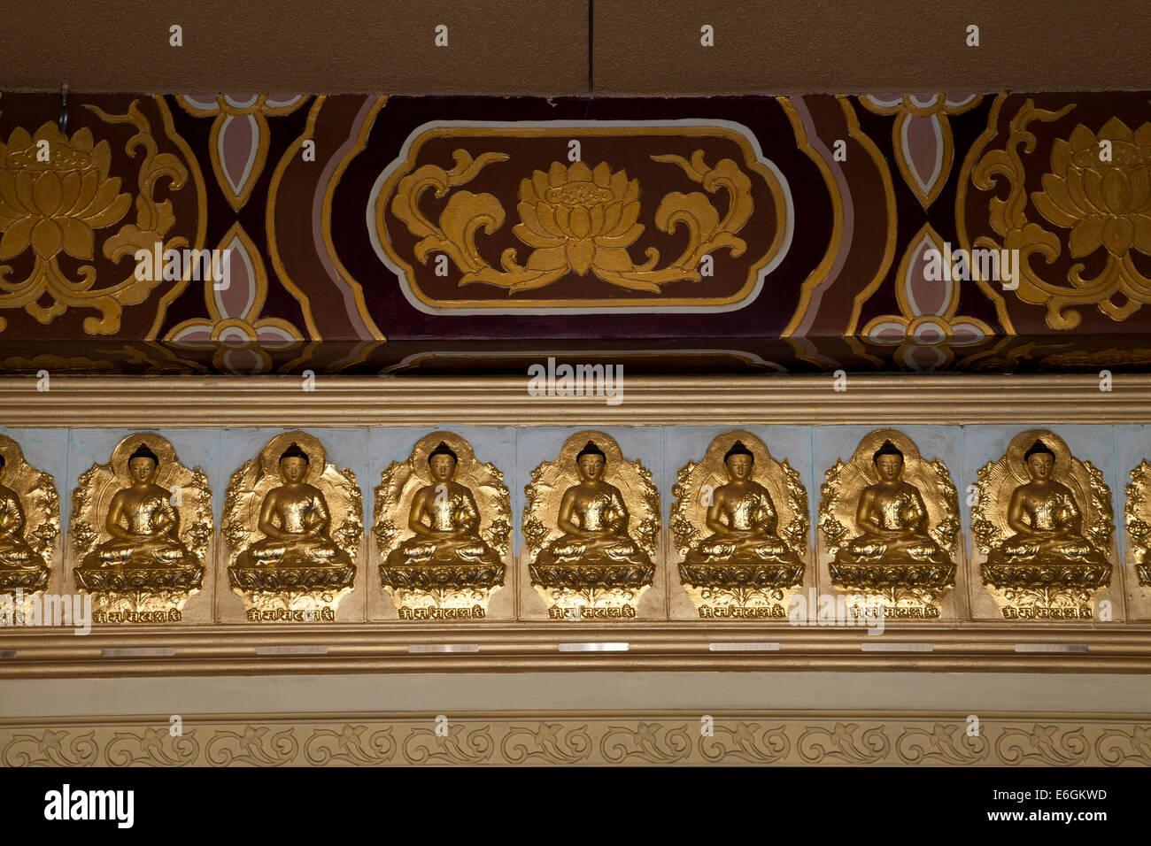Figures of gold Buddha adorning the interior corridor of the Hsi Lai Buddhist Temple, Hacienda Heights, California, - Stock Image