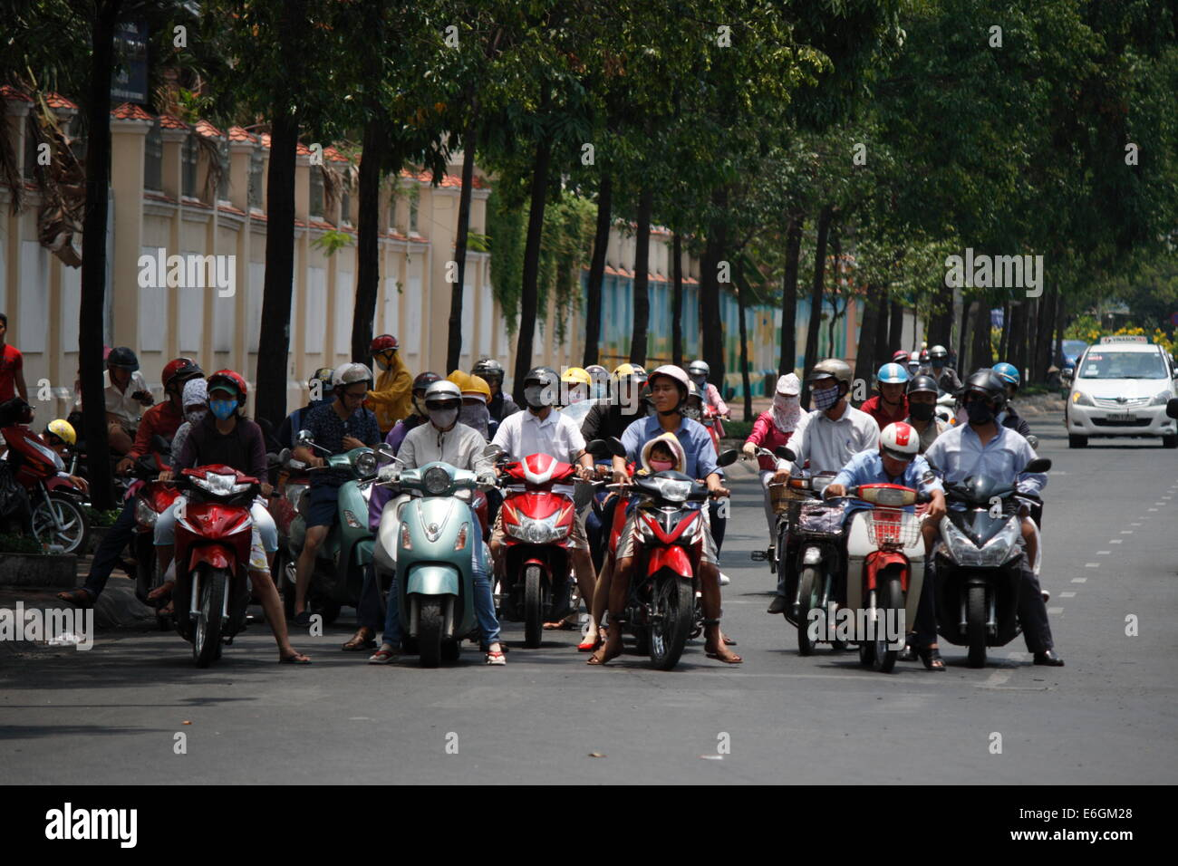 motorists stopping at traffic junction in Ho Chi Minh city, Vietnam - Stock Image