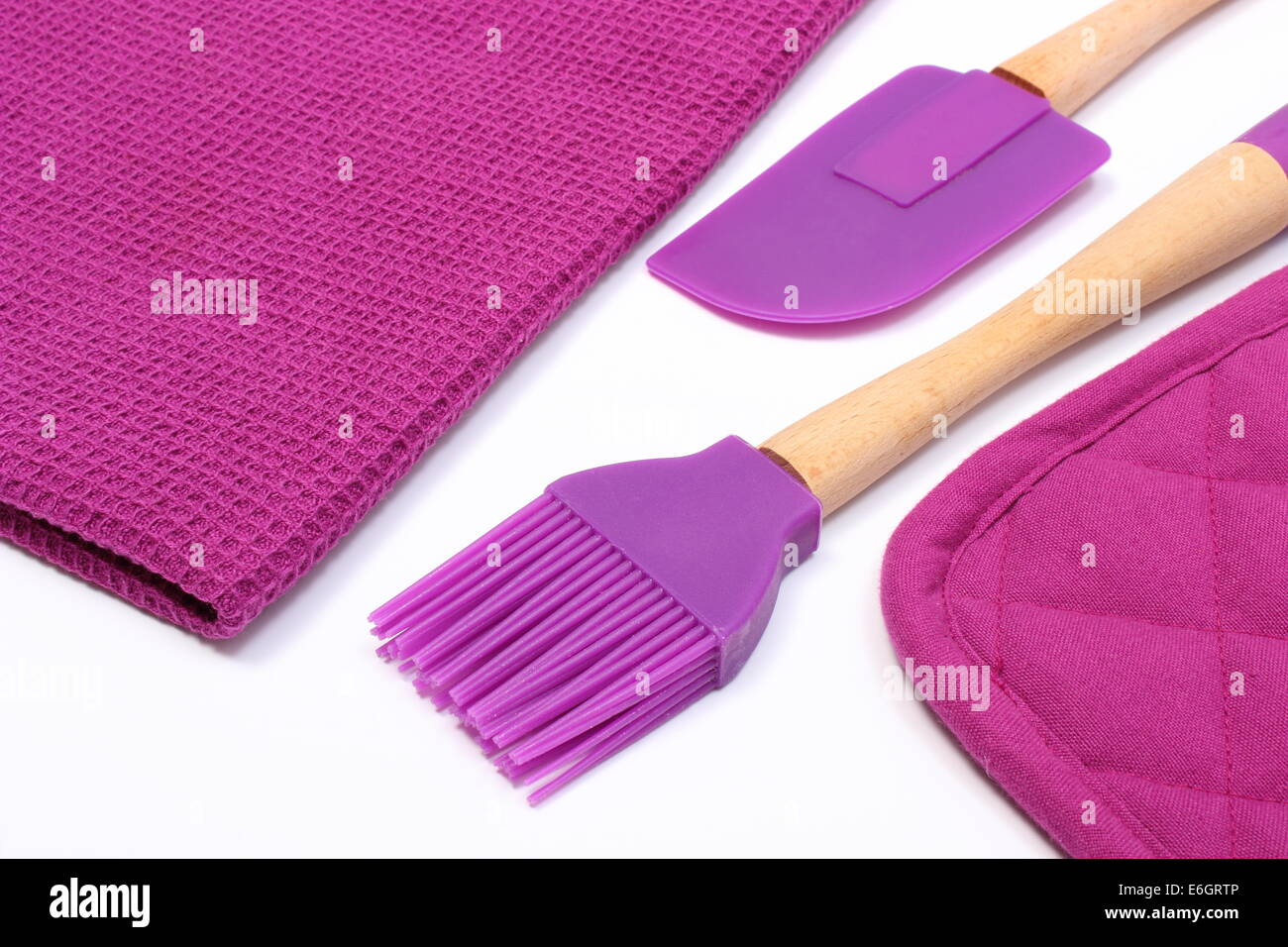 Purple silicone kitchen accessories on white background ...