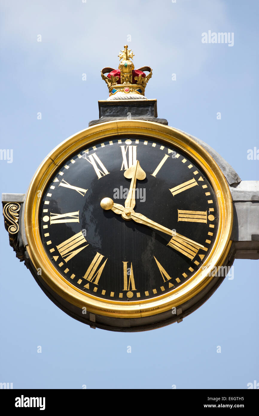 Clock projecting from the church of St Edmund King & Martyr in Lombard Street, London, England. - Stock Image
