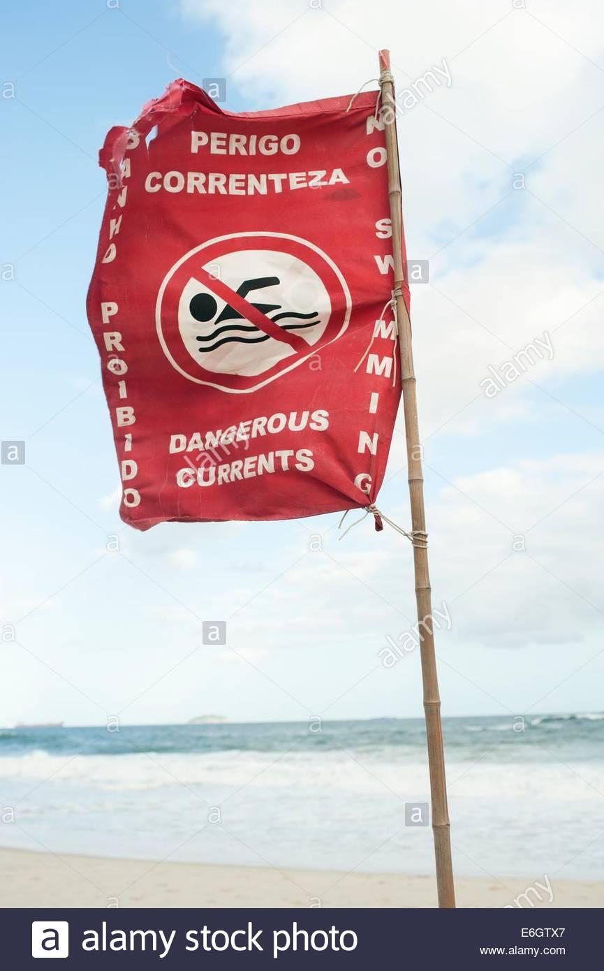 Brazil Rio de Janeiro Ipanema Beach Flag warning swimmers of the dangerous currents. - Stock Image