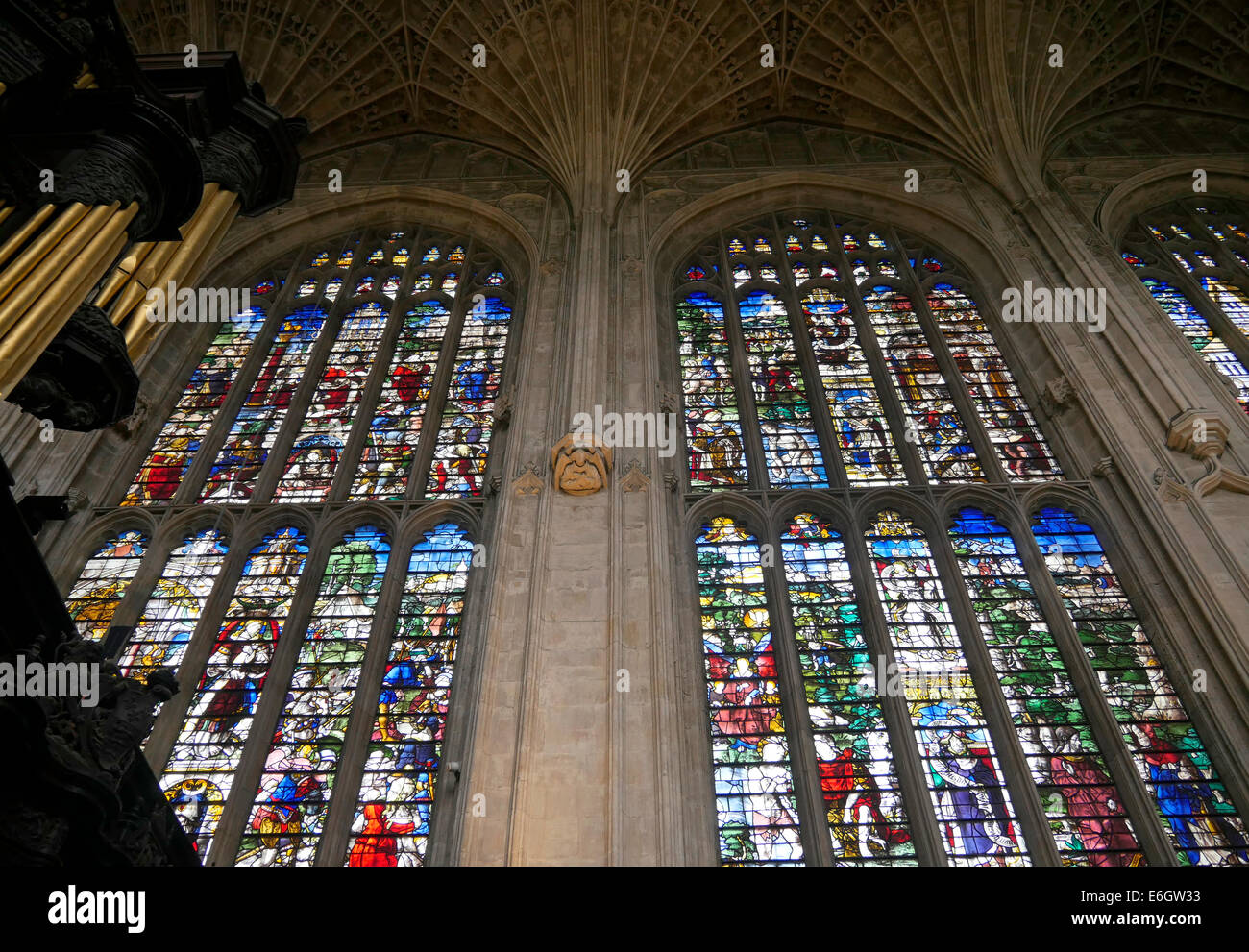 interior of kings college chapel cambridge england showing the chapel organ and stained glass windows - Stock Image