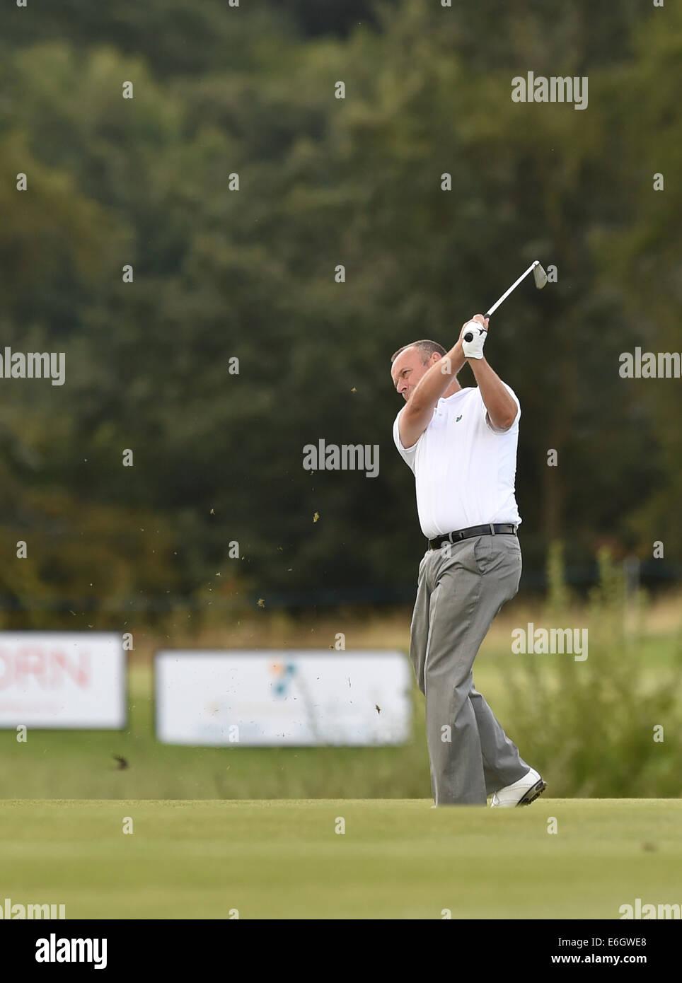 Darlington, UK. 23rd Aug, 2014. English Senior Open Golf. Rockcliffe Hall. Jamie Spence hitting off the fairway - Stock Image