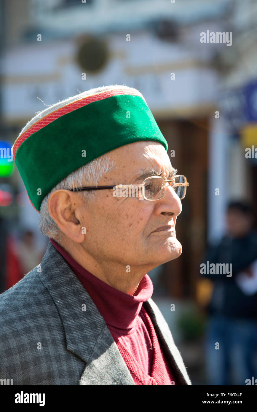 A local resident wearing his rampouri green hat in Shimla in Himachal Pradesh,India - Stock Image