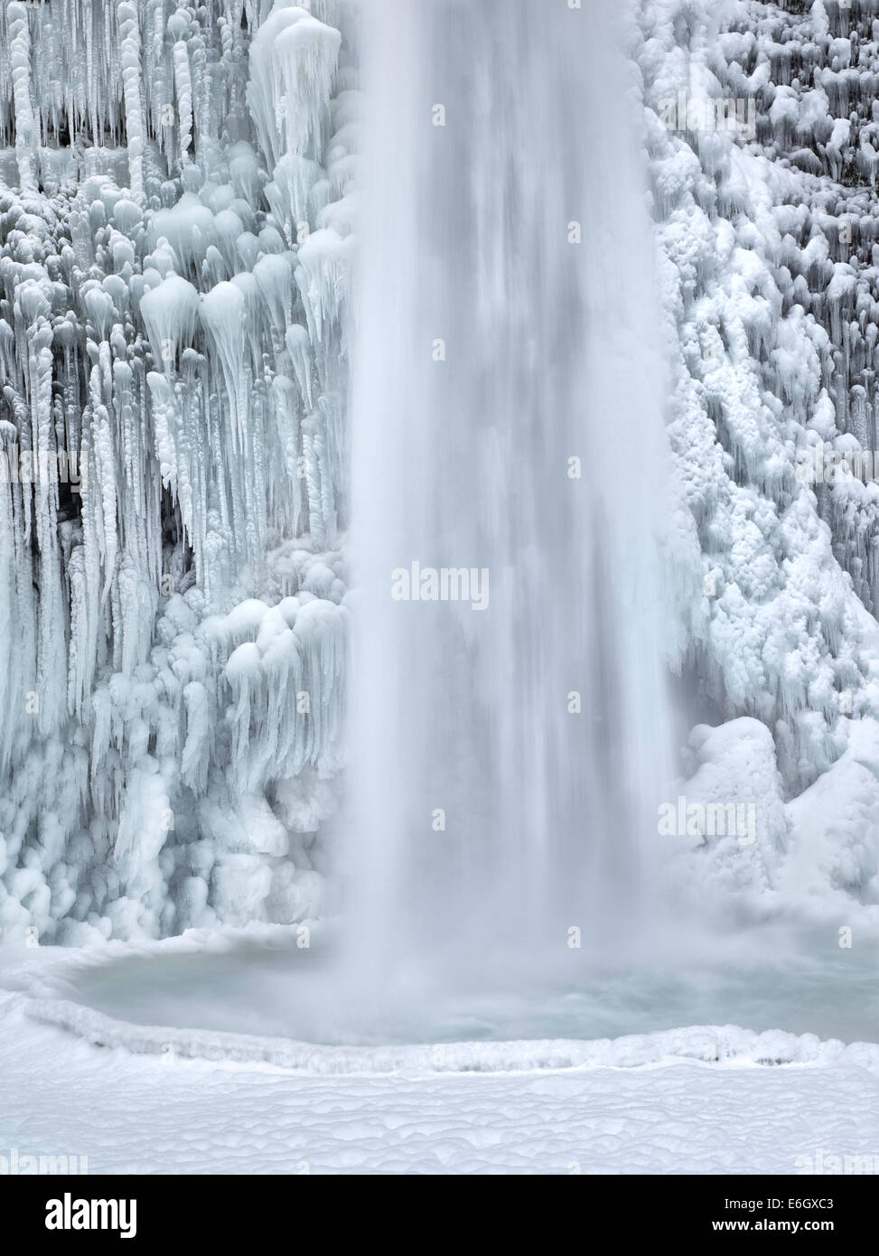 Close up of Horsetail Falls with ice and snow. Columbia River Gorge National Scenic Area, Oregon - Stock Image