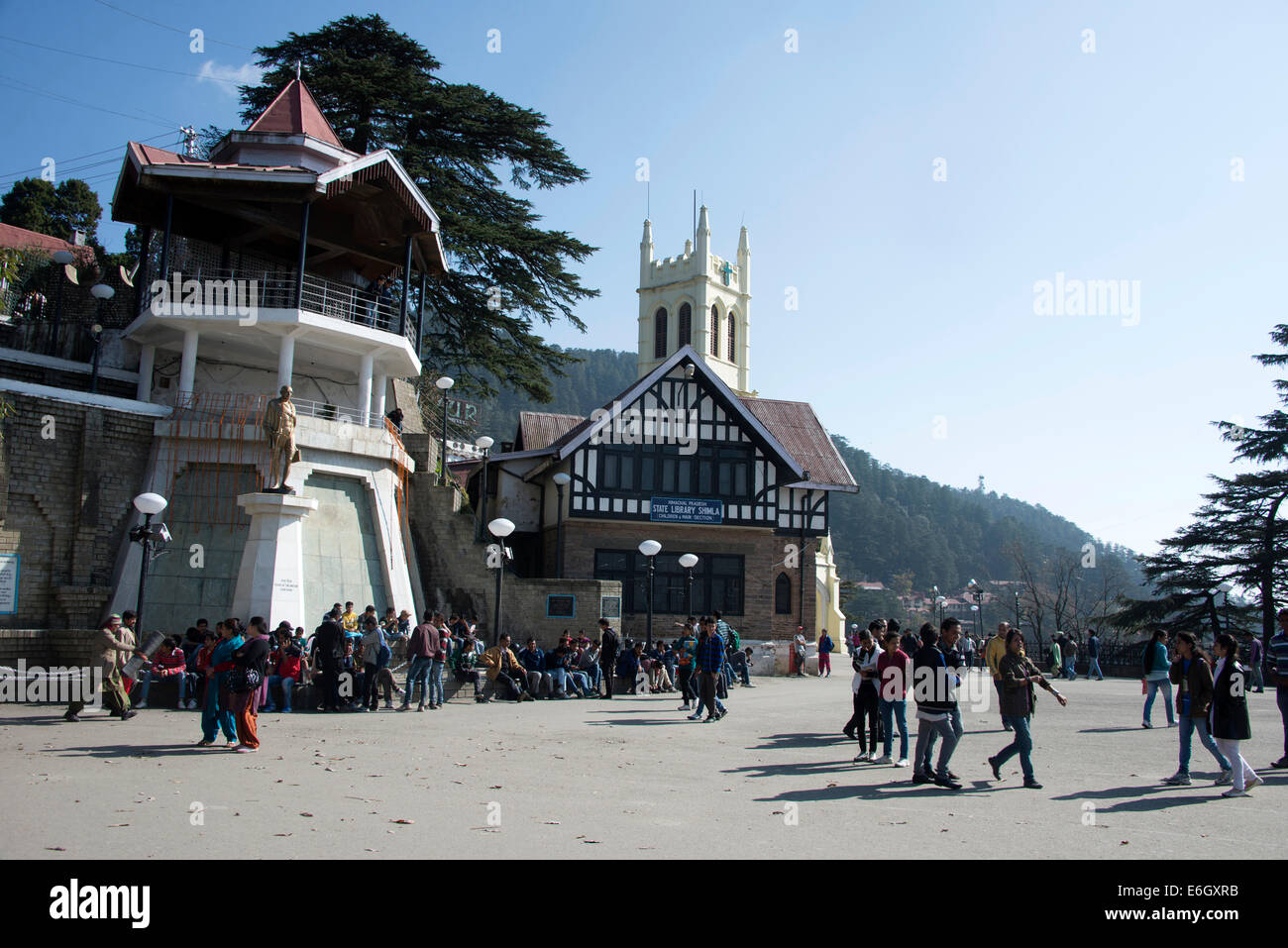 Visitors on the Ridge with Christ Church tower in Shimla ,Himachal Pradesh,India - Stock Image