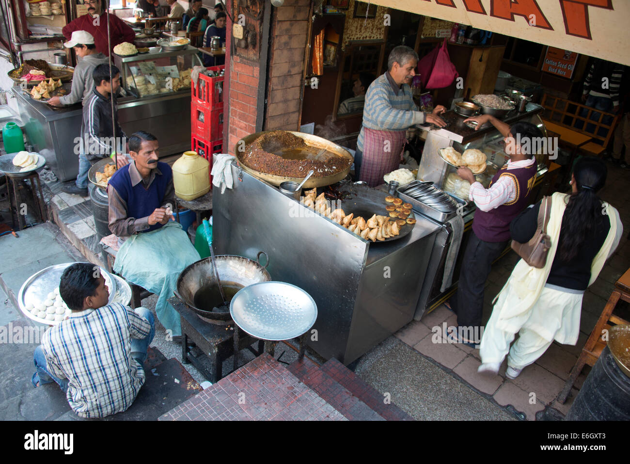 Two bakery employees making fresh Chapati (bread) at a restaurant in Shimla,  Himachal Pradesh, India - Stock Image