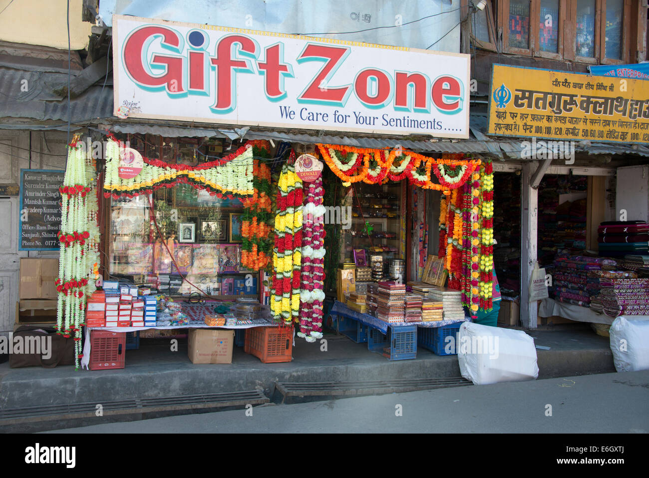 An Indian shop in Shimla with hanging garlands for the Diwali festival. Shimla  is in Himachal Pradesh, India - Stock Image