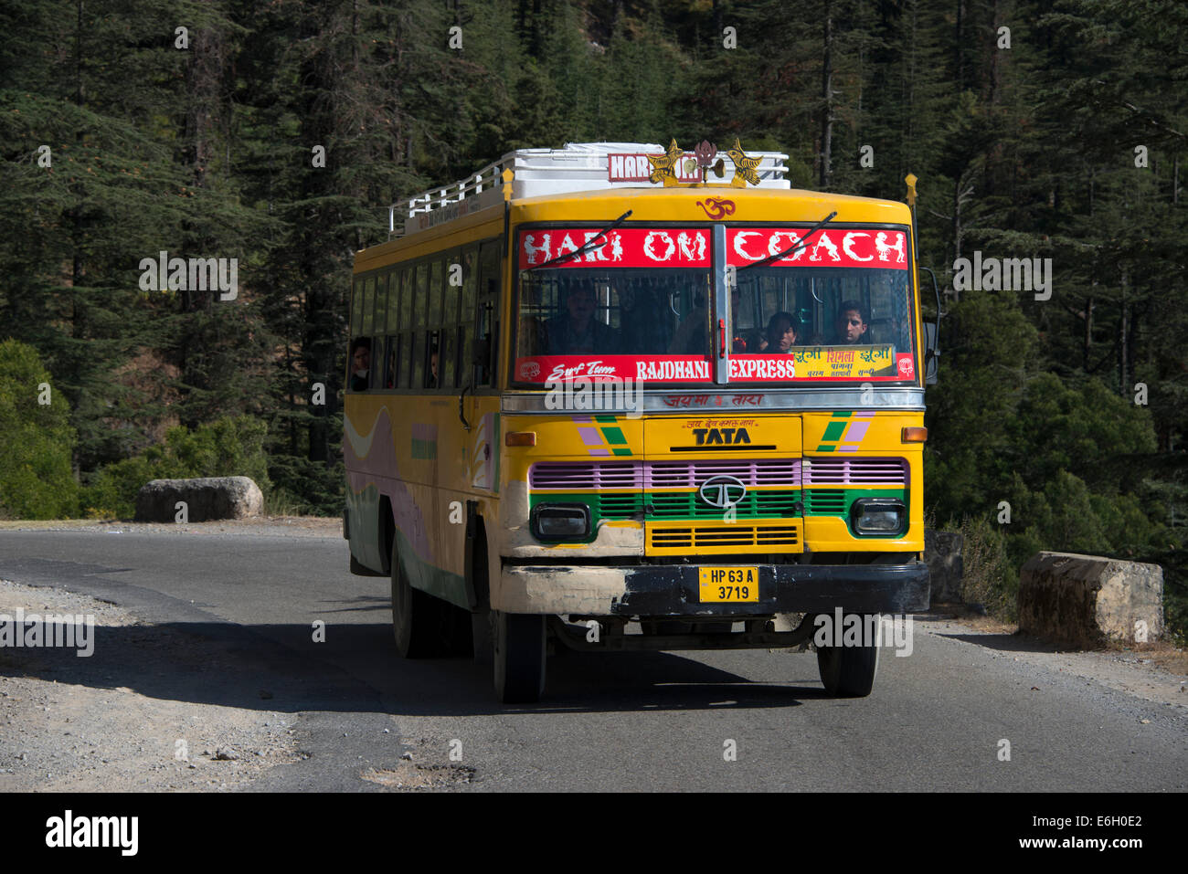 An Indian TATA bus of the Rajdhani Express on a mountain road in the Himalayan foothills in Himachal Pradesh,India - Stock Image