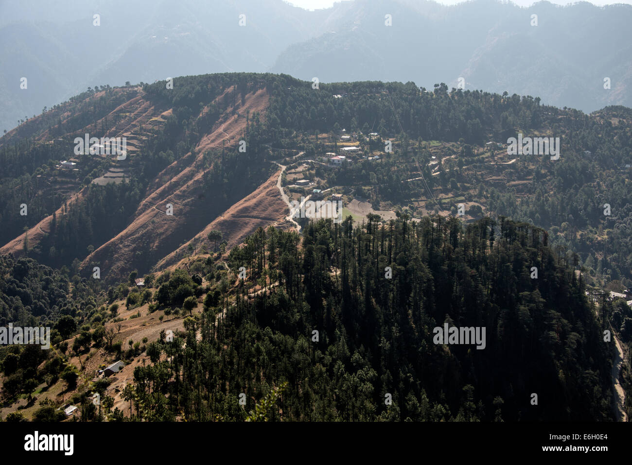 A mountain backdrop and farming country in the Himalayan foothills in Himachal Pradesh,India - Stock Image