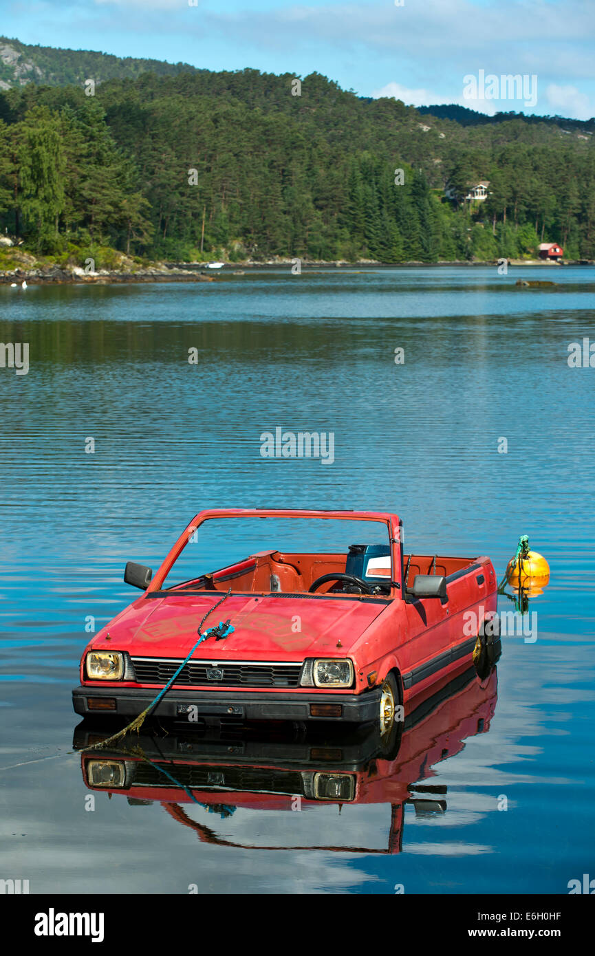 A Subaru passenger car turned into a boat floating on a lake, Norway - Stock Image