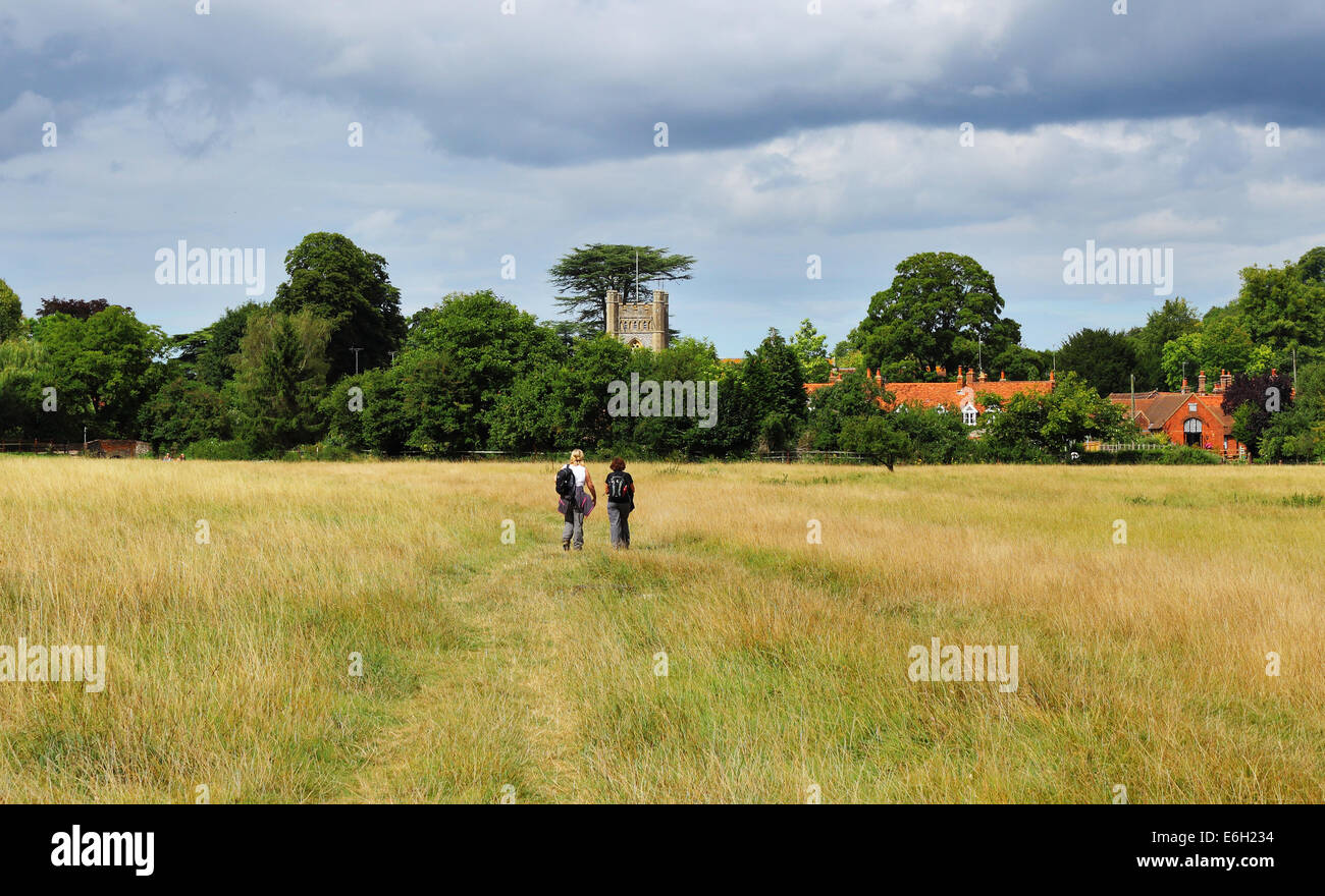 Lady Ramblers on an English Rural through a meadow with in the Chiltern village of Hambleden - Stock Image