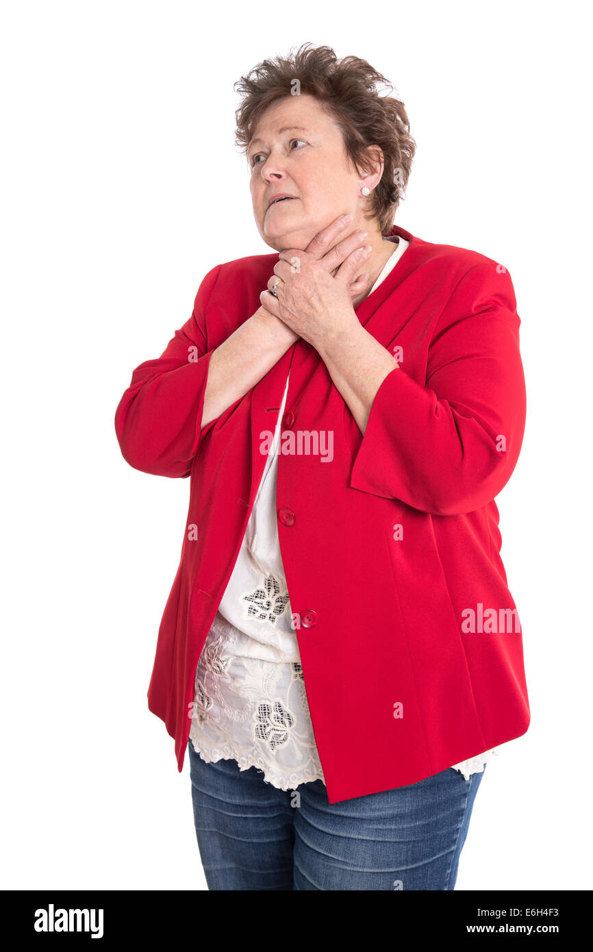 Portrait of an isolated older woman in red has sore throat. - Stock Image