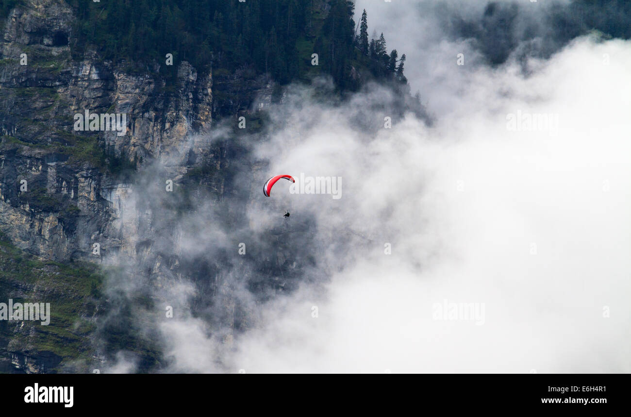 Paraglider flying above Lauterbrunnen Valley, Switzerland - Stock Image