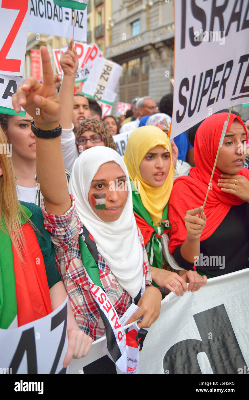 Women demanding peace and protesting against Israeli attacks in the Gaza Strip during a demonstration in Madrid - Stock Image