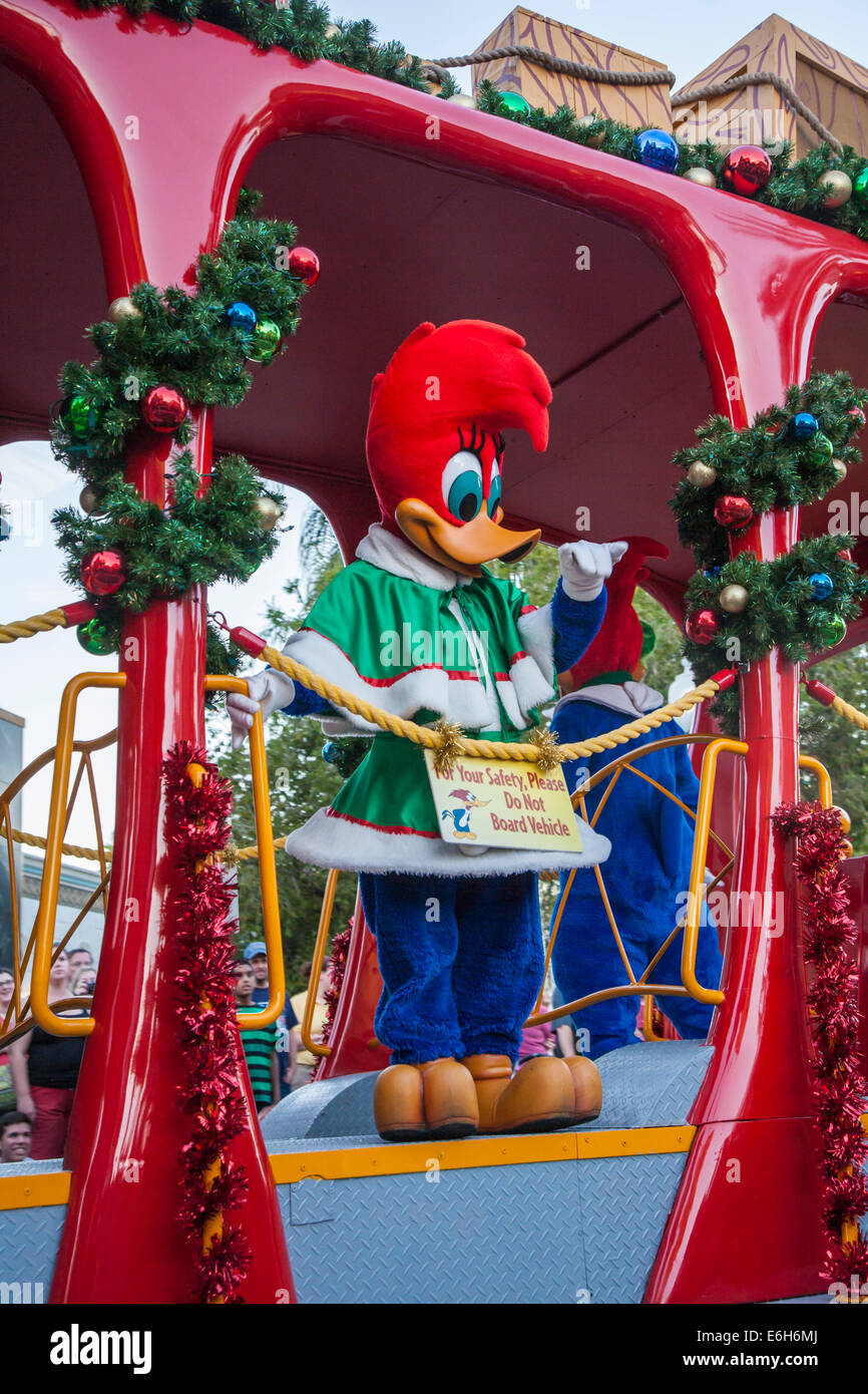Woody Woodpecker rides a float in the Macy's Holiday Parade at Universal Studios, Orlando, Florida - Stock Image