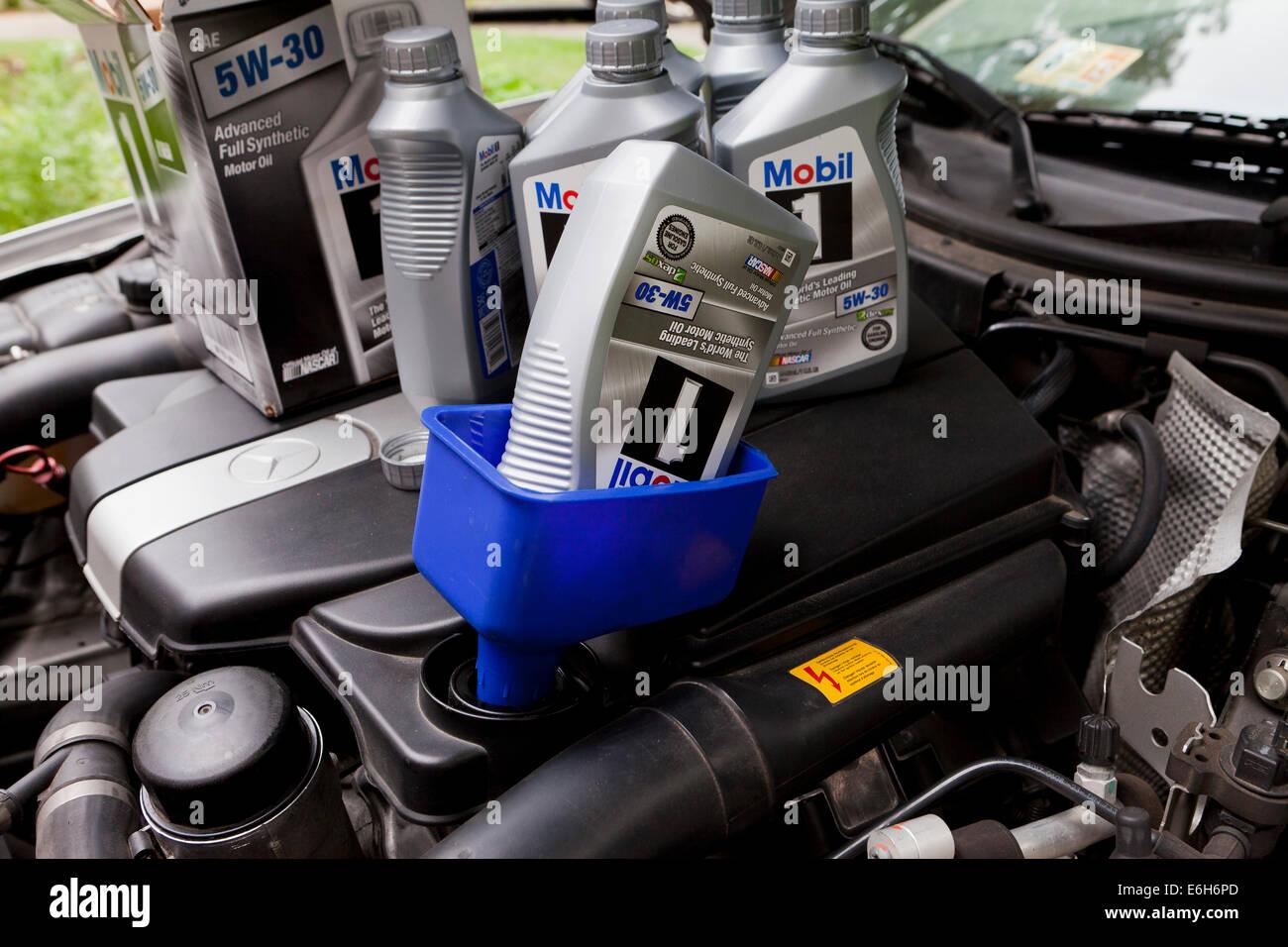 Mobile 1 motor oil in funnel - USA - Stock Image