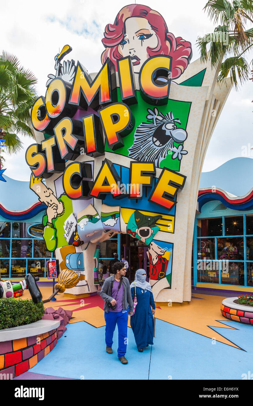 Muslim couple leaving Comic Strip Cafe in Toon Lagoon at Universal Studios Islands of Adventure in Orlando, Florida - Stock Image