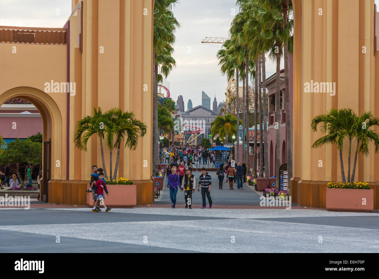 Park guests at entrance to Universal Studios theme park in Orlando, Florida - Stock Image